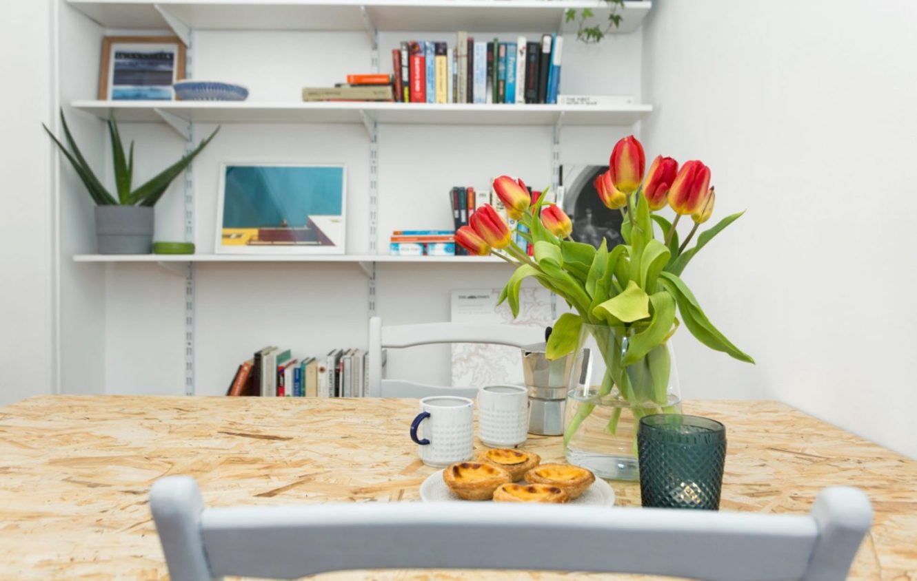 Dinning room with diy table wall library and flower decorations