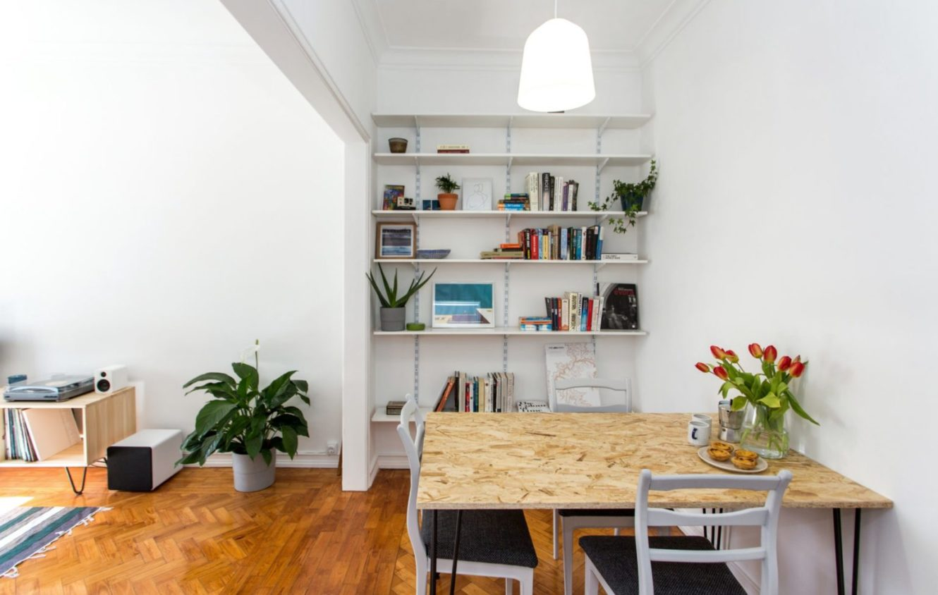 Dinning room with a wall library plant decoration and entrance to the living room